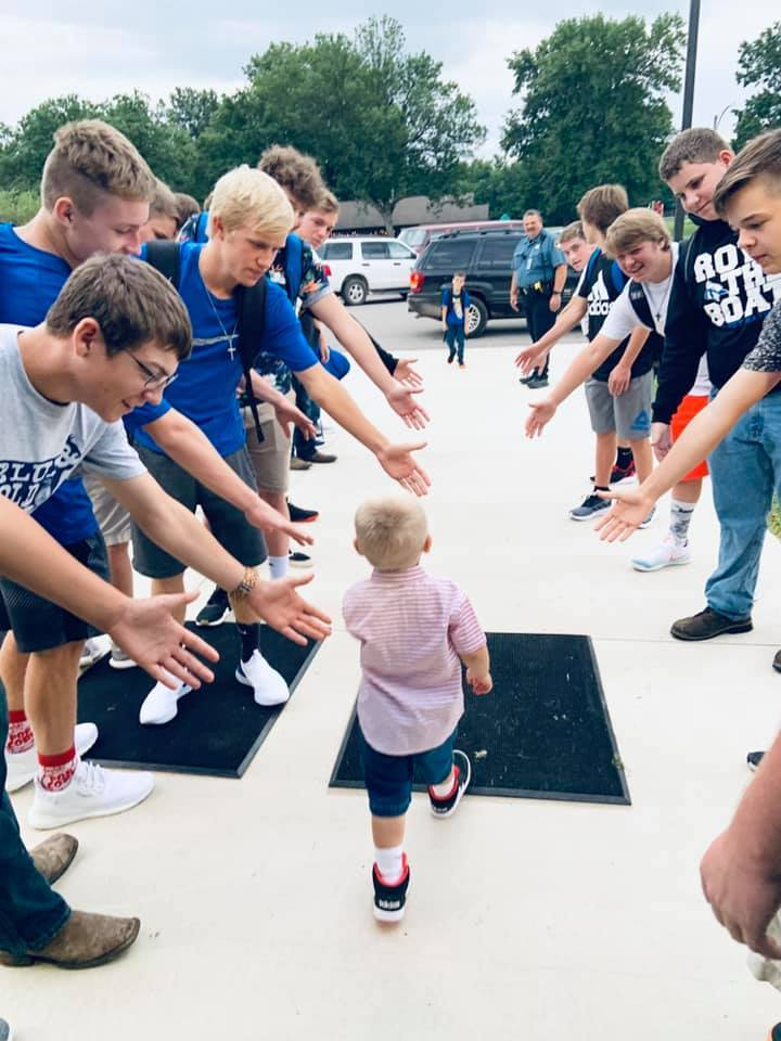 Future Blu-Jay gets high fives from the High School Football Team. Now a game day and special day tradition, our TEAM greets all the elementary students!